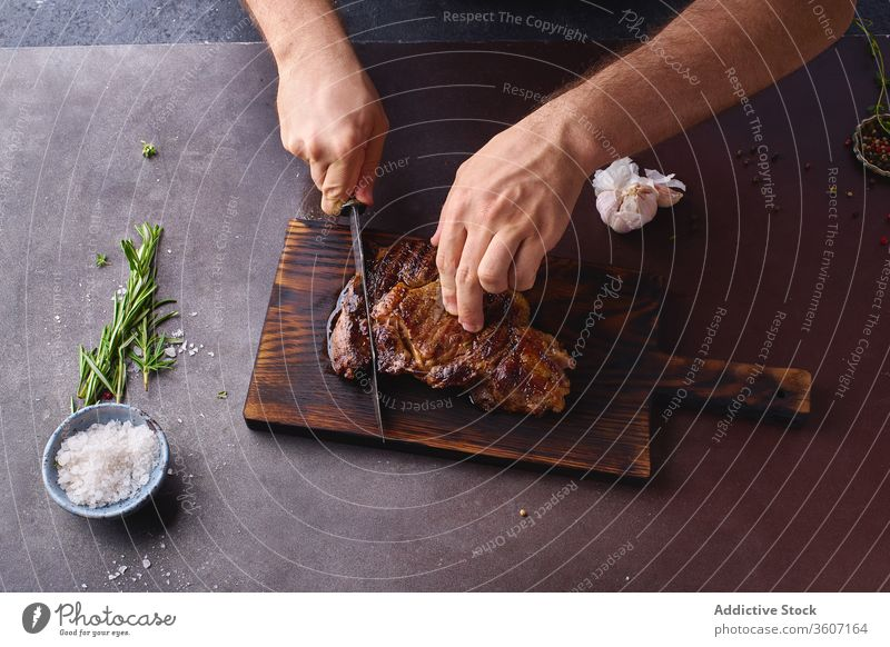 Hands cutting beef steak ribeye grilled black angus food meat cuisine hands beefsteak roasted tasty sliced closeup salt cooking filet protein fresh healthy