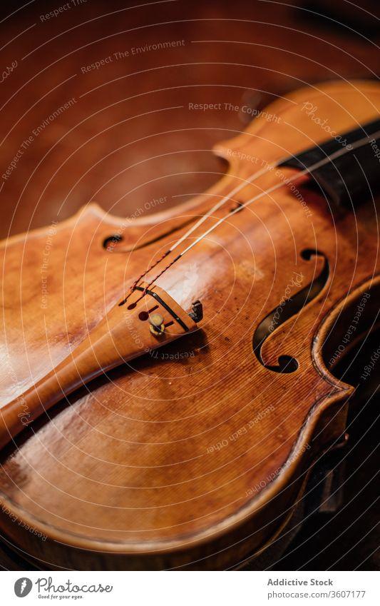 Handmade violin in workshop string sound craftsman regulate soundboard skill acoustic process professional handmade workplace manual instrument tune tradition