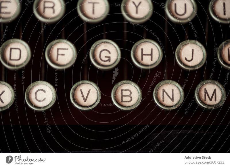 Keyboard of vintage typewriter with round buttons key keyboard retro letter old fashioned antique number alphabet nostalgia aged creative hobby art grunge