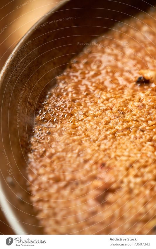 Vertical photo of rice grains in a paella while cooking vertical spanish food cuisine traditional dinner mediterranean dish cooked background fish gourmet