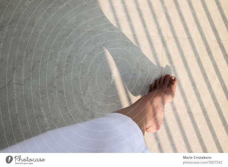 Shadow lines over a woman's foot showing concept of feminism, gender equality and women's rights Women's Day International Women's Day Conceptual shadow lines