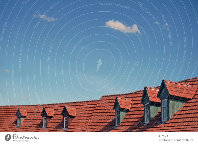 six dormer windows in a row on a tiled roof with blue sky and small fair weather clouds Skylight Window Tiled roof decorative cloud Dormer Roofing tile Exposure