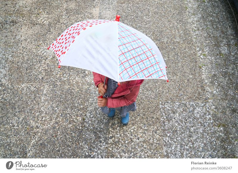four-year-old girl with umbrella and rubber boots Autumn Beauty & Beauty Blonde Boots Cheerful Child City Colour Dress Woman fun Funny Girl Happiness Jump Legs