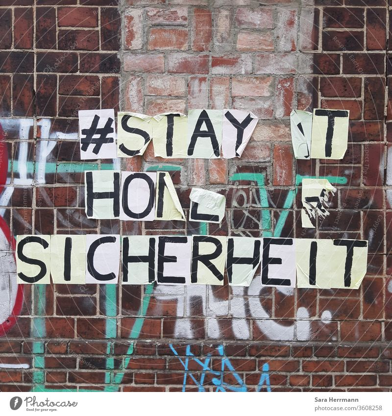 A detached writing on a brick wall Safety stay at home Berlin Corona virus Protection street art hash day