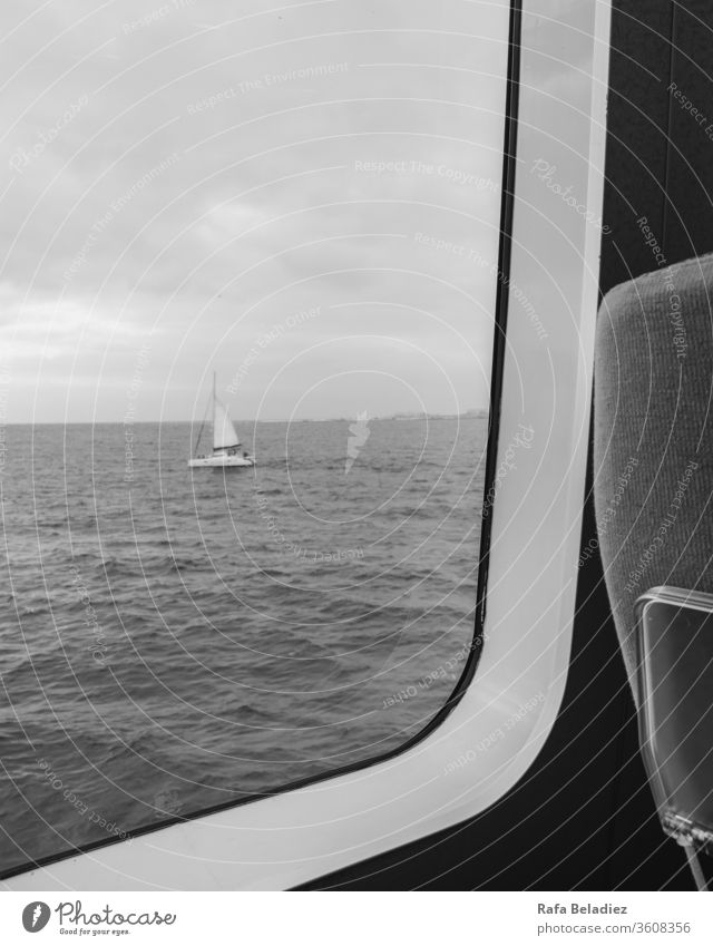 Sailboat seen from inside a ferry Ocean Baltic Sea Summer Sailing Sailing ship Water Maritime Beach life Handicraft flag Vacation & Travel paper boat Freedom