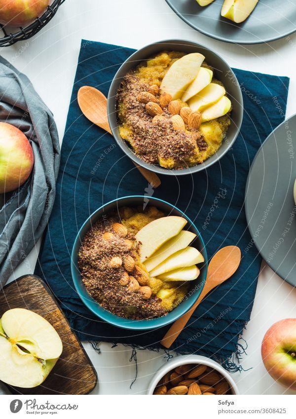 Cozy Breakfast food concept with turmeric amaranth breakfast morning plant based food bowl cozy apples golden almond recipe still life flat lay porridge served
