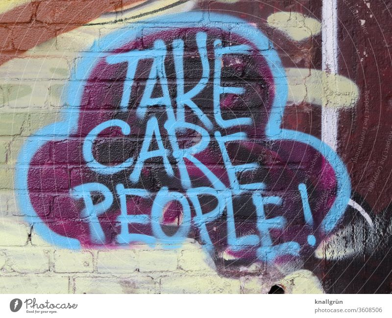 Blue graffiti on a brick wall Graffiti Caution people Lifestyle Emotions Exterior shot Speech bubble variegated Colour photo Wall (building) Day Wall (barrier)