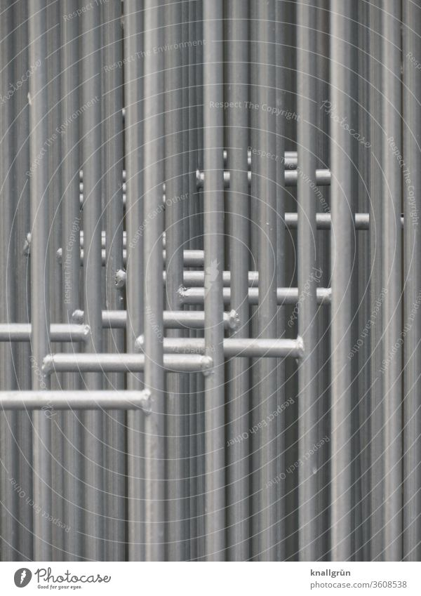 Close-up of several barrier grids standing one behind the other Protective Grating Barrier Safety Protection Exterior shot Fence Metal Border
