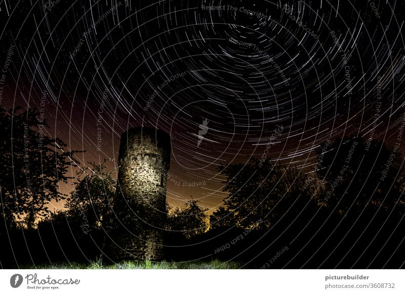 Star trails above the old watchtower stars Starry sky Sky startrails Watch tower clear Night Forest Light Restless Time Deserted rotation rotation axis