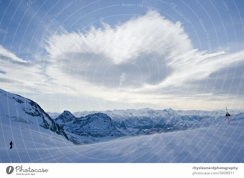 Blue mountain view with Ice and Snow pale blue cold icy snow ski expansive landscape mountains ski run fresh crisp winter altitude heart shape open barren