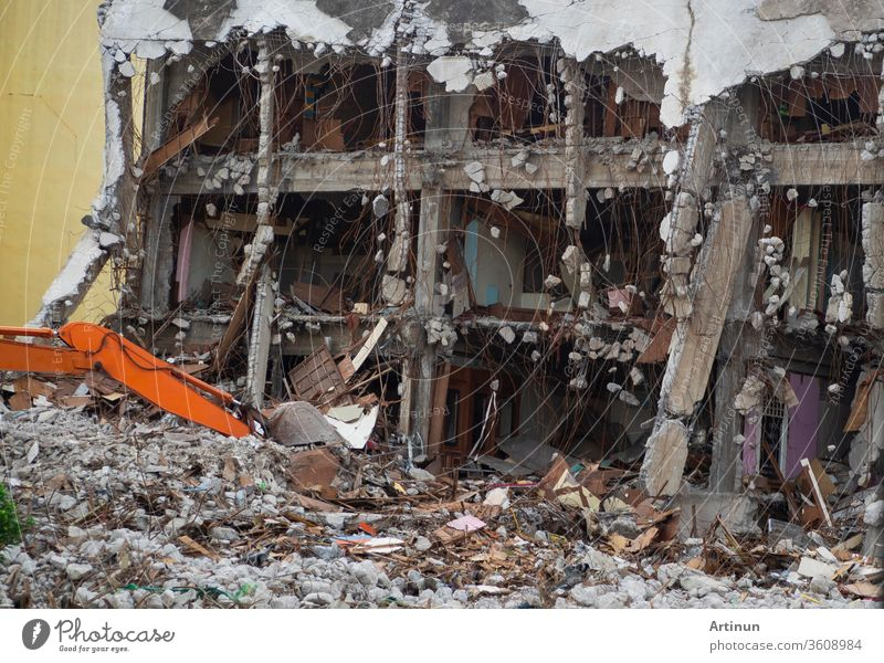 Destroyed building industrial. Building demolition by explosion. Abandoned concrete building with rubble and scrap. Earthquake ruin. Damaged or collapsed building from hurricane disaster.