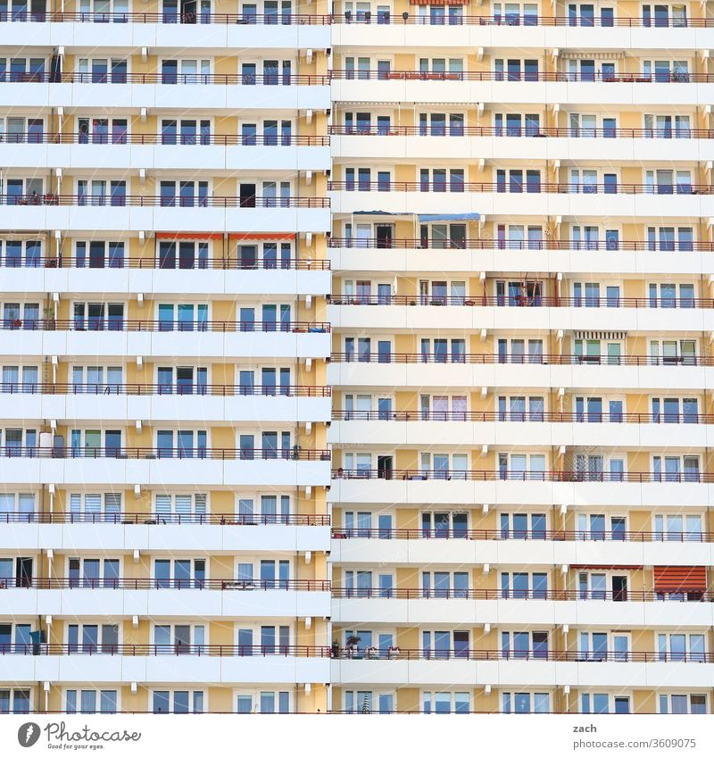 View of a facade of a Berlin high-rise building with balconies and windows Loneliness Concrete Living or residing New building GDR Marzahn Marzahn-Hellersdorf