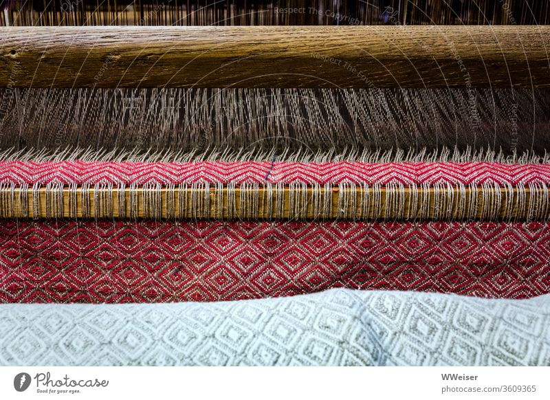 A cloth is made in a loom Loom Weaving Rag Cloth threads Craft (trade) textile Pattern colors Folklore Material weave Handcrafts hand woven traditionally