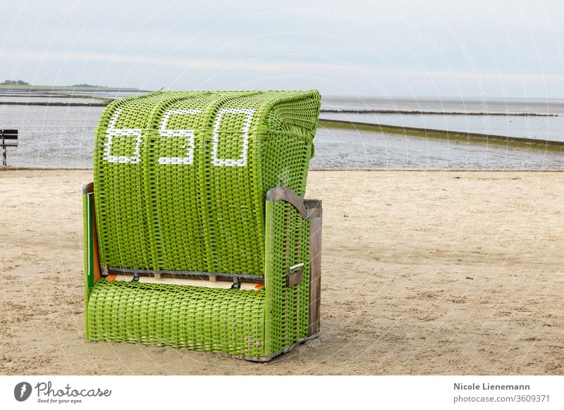 Beach chair on the North Sea beach in Germany beach chair green north sea germany sky water blue ocean travel landscape nature coast summer shore wave cloud