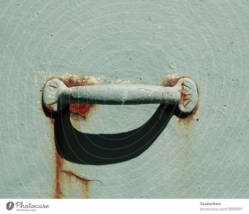 handle on steel door in mint green with traces of rust Door handle Industrial Rust Brown Screw Rust marks Shadow Old Solid Robust stop To hold on Metal Detail