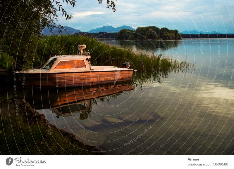 The fast day is gone Lake Lakeside Evening boat sunset ship Island mountains Idyll silent Sunset Sunlight Calm bank reed Stop short consolation romantic
