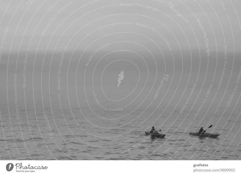 Lonely kayaks black-and-white White Black Canoe Sports Loneliness togetherness Sports Training North by oneself Water Ocean Canoeing in pairs Exterior shot