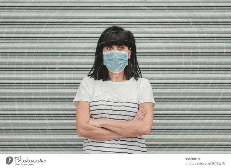 woman wearing medical mask for coronavirus on the street young woman covid-19 summer epidemic pandemic quarantine cool walk gloves health care lifestyle sign