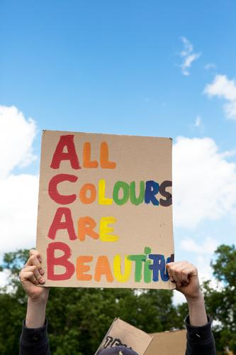 All colours are beautiful.black lives matter - Demonstration in Cologne on 06.06.2020. BLM, blacklivesmatter, against racism and police violence.Colourful writing on a cardboard sign