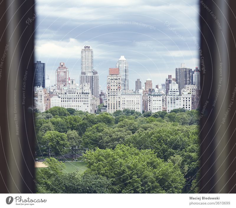 Central Park and Manhattan Upper East Side seen through a window, New York. City USA architecture urban toned filtered park building retro view sky cityscape