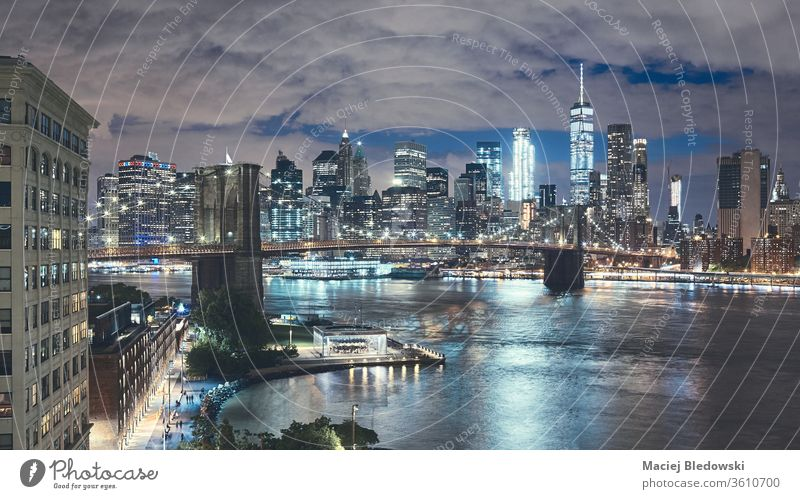 New York City seen from Brooklyn Dumbo at night, USA. skyscraper new york city america manhattan skyline Brooklyn Bridge business building panorama office