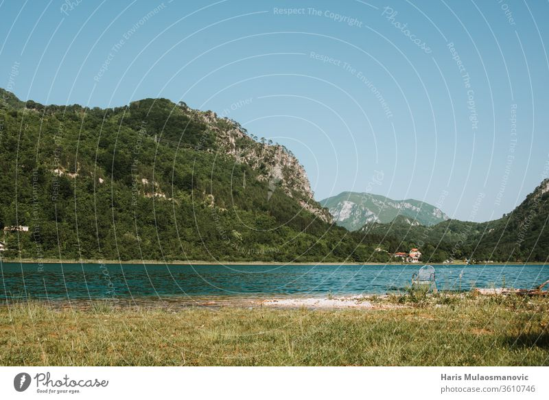 Beautiful view on the green peaceful lake surrounded by mountains alone background bay beach beautiful board boracko boracko lake dock environment fishing
