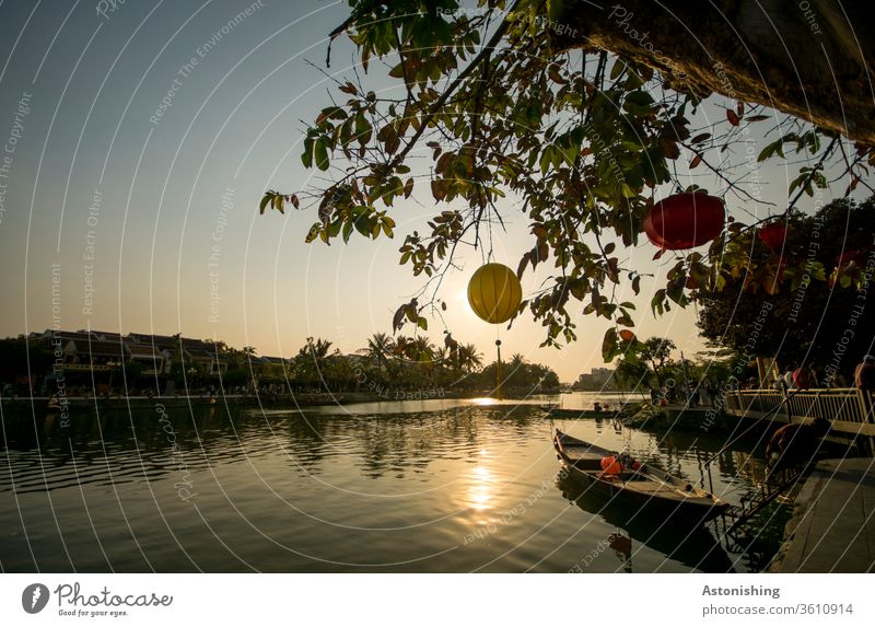 Evening light with lanterns at the river in Hoi An, Vietnam Lantern evening light Sun Sunlight boat River Rowboat tree leaves Sky Nature Twilight Thu Bon Water