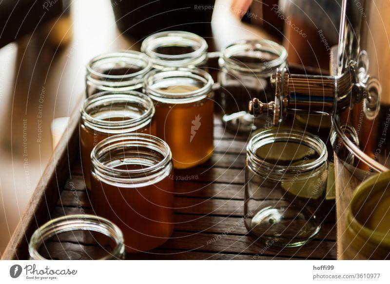 a jar of honey is bottled Bee-keeping Bee-keeper keep beekeepers Honey honey production organic farming ecologic Honey bee Food Healthy Summer Apiary Beehive
