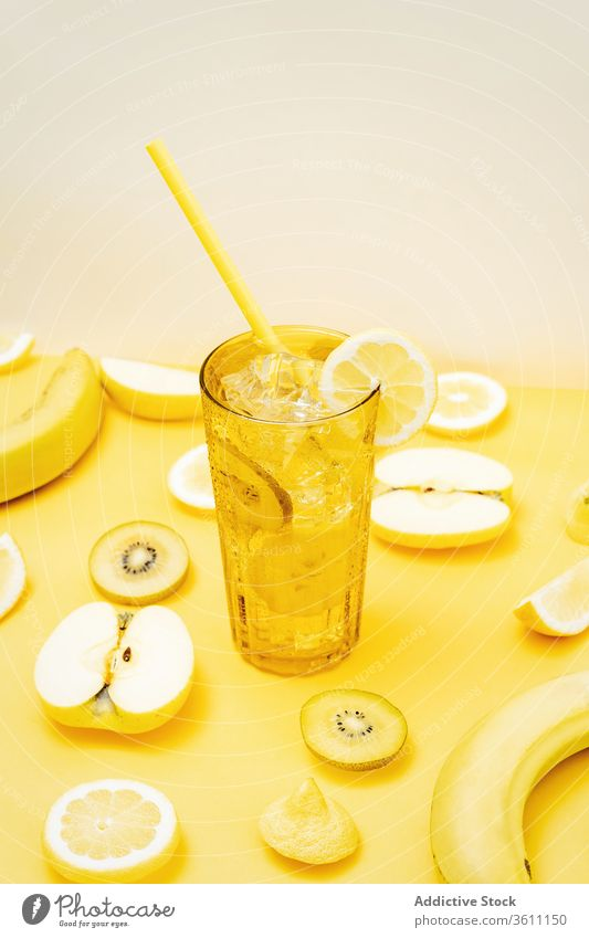 Refreshing fruits and cocktail on yellow background refreshment color vibrant vivid beverage creative healthy food glass arrangement various composition drink