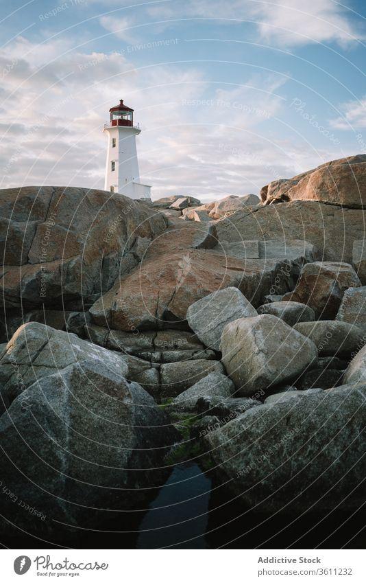 Lighthouse against cloudy sundown sky lighthouse sea shore sunset water peggys cove canada dusk twilight ocean coast nature weather idyllic scenic nobody rock
