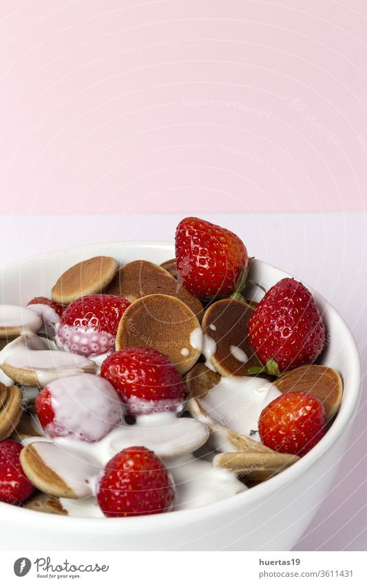 Homemade cereals mini pancake with yogurt, honey and strawberries on colorful background. homemade pankakes delicious food dessert vegan food healthy tasty