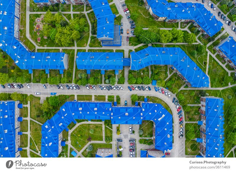 """OLKUSZ, POLAND - JUNE 03, 2020: Aerial view of the housing estate with blue roofs. Estate Sloviki located on Witosa street is also called """" Smurfs"""" Olkusz, Poland."""