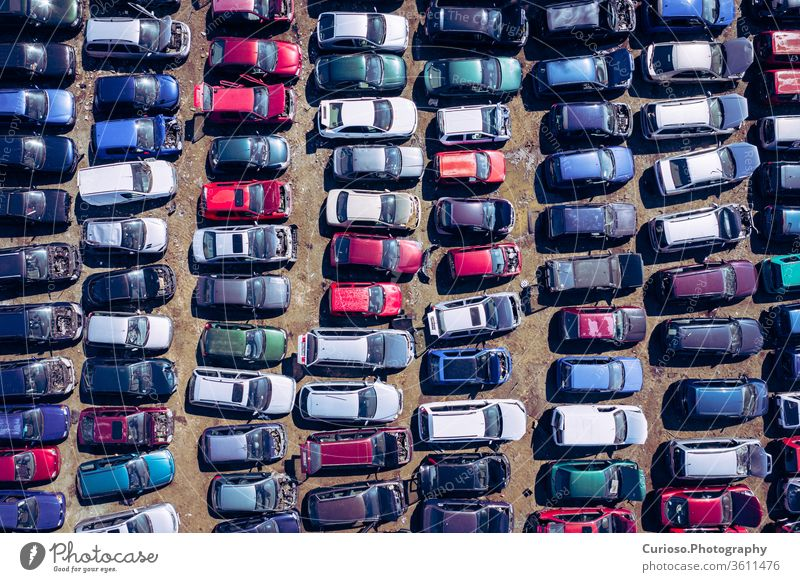 Aerial view of the junkyard. Old rusty corroded cars at the junkyard. Car recycling industry from above. Applied vehicles drones Antenna parts Scrapyard