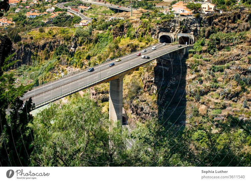 high motorway bridge with tunnel in the mountains Madeira Portugal Car bridge Highway Street Transport Traffic infrastructure Colour photo Motoring Road traffic