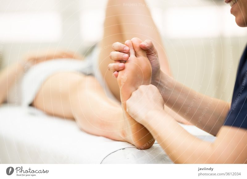 Medical massage at the foot in a physiotherapy center woman leg chiropractor physical physiotherapist patient rehab clinic care health treatment shoulder