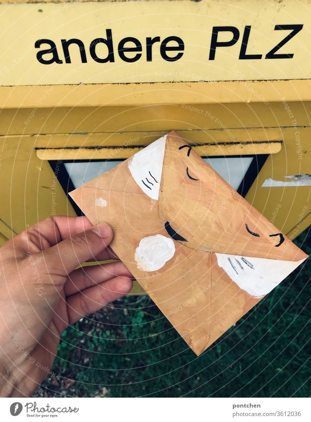 Hand throws an envelope painted as a fox into the letter slot for other postcodes in the mailbox. Invitation to a child's birthday party Mailbox Lettering