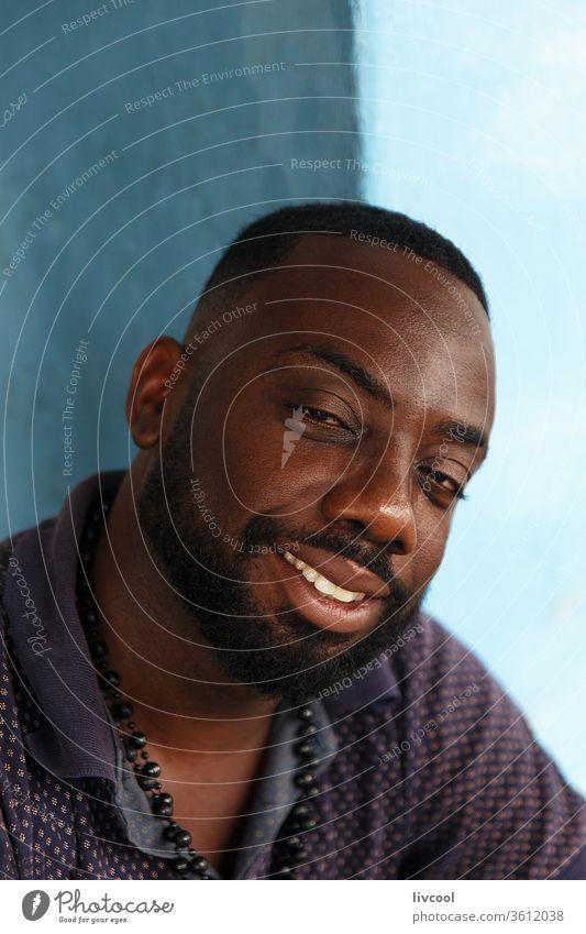 nice cuban man from cienfuegos, cuba attractive beard smile smiling happy people lifestyle human blue wall caribbean island che guevara portrait enjoy senior