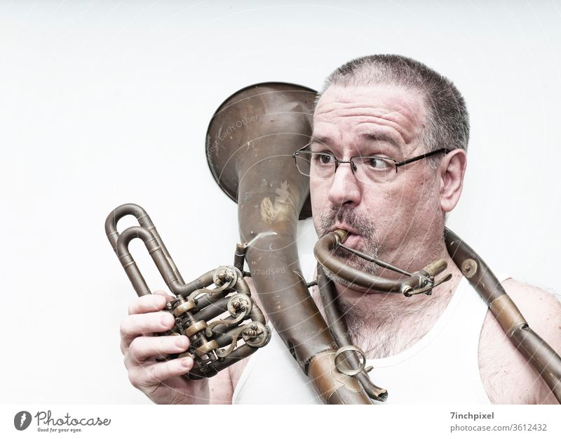 Squinty man in undershirt with broken tenor horn Man exempt Brass instrument Cor anglais Undershirt Eyeglasses Facial hair Person wearing glasses Adults Funster