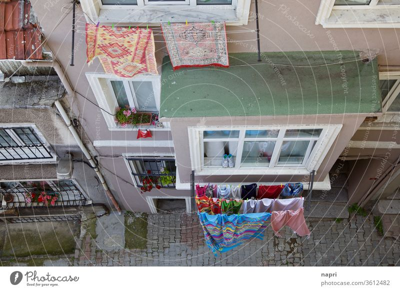 Drying time | laundry hangs to dry on clotheslines outside the windows of a house in a narrow alley of Istanbul. from on high Clothesline Household Alley