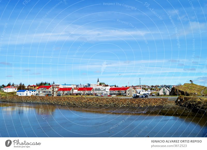 Borgarnes village view with waer fjord reflection in a sunny day, Iceland water nature city sea scenery snow travel north house cold snowy landscape blue