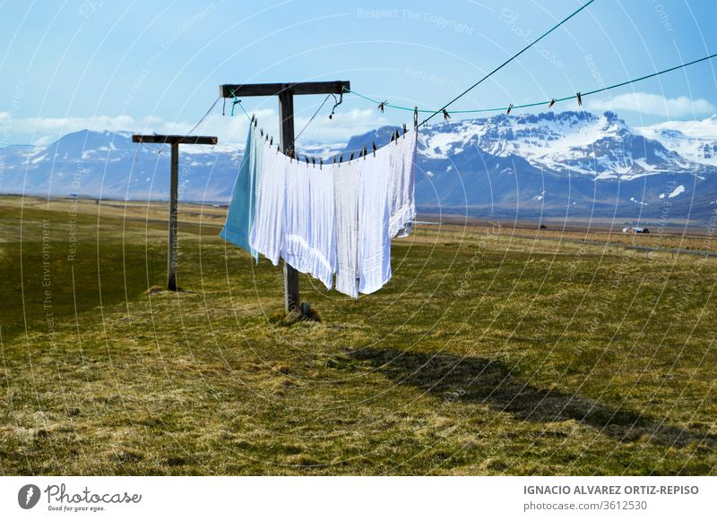 Laundry hanging clothes and towels outdoors with a great background laundry summer day sky wind rope clothesline nature fresh wash clean blue spring linens