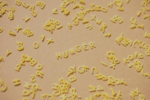 The word hunger from alphabet noodles Noodles world hunger Eating food products Food Appetite Lunch Dinner Alphabet noodles Nutrition Carbohydrates pasta gluten