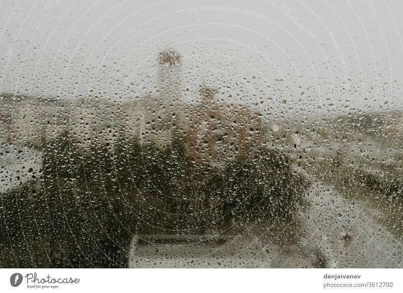 Wet window against the background of an evening view of the city raindrop water abstract wet texture nature glass weather rainy aqua urban liquid reflection