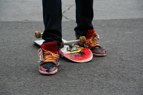 Skater action active balance board boy child city cool culture exercise extreme fashion feet foot freestyle fun grunge jeans kid leg legs lifestyle modern