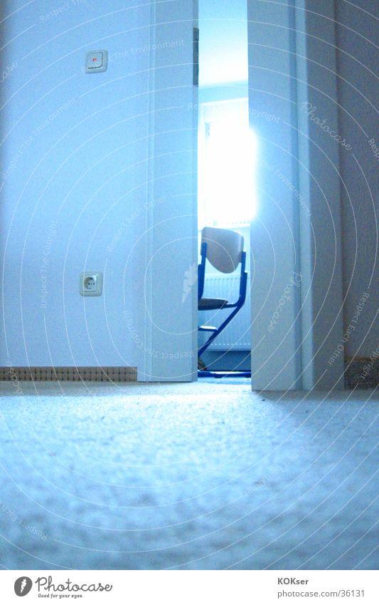 Sun Chair Floor covering Living or residing Shaft of light Slightly open door