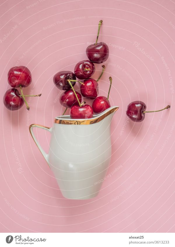 Cherries in white bowl on pink background agriculture berry cherry color eat food fresh freshness fruit garden gourmet healthy ingredient juicy natural nature