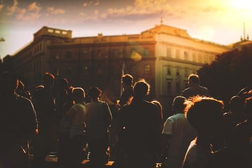 Street life, silhouetted crowd of people at sunset in the city colleague group multiethnic occupation worker connection union job white global career women dusk