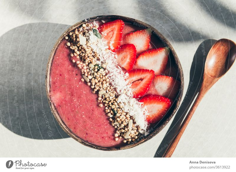Strawberry Smoothie in Coconut Bowl smoothie healthy bowl coconut detox banana strawberry raspberry food vegan granola fruit breakfast organic oat yogurt pink