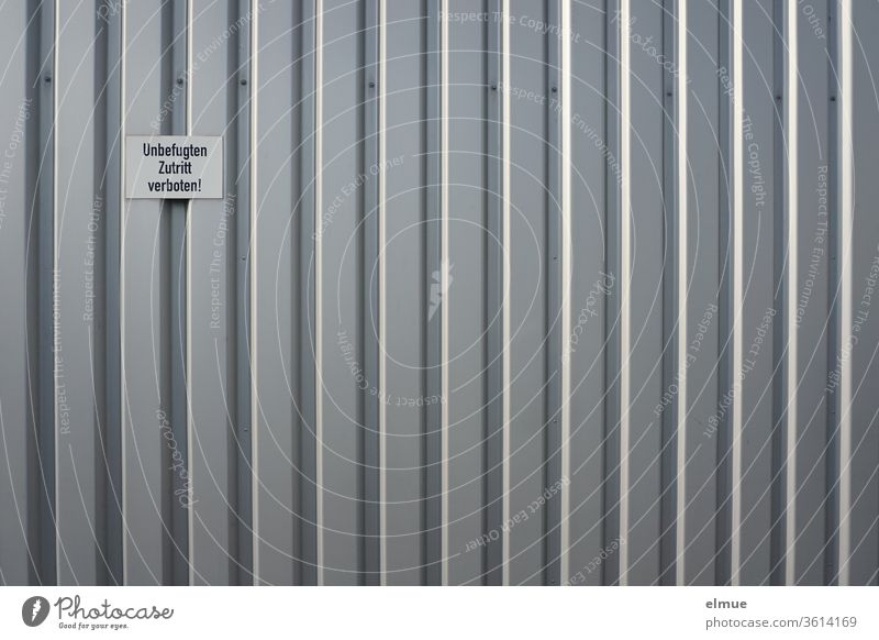 """No Trespassing"" sign on a gray metal facade No admittance metal gate Facade Gray Working environment unauthorized interdiction Stripe Admission Closed"