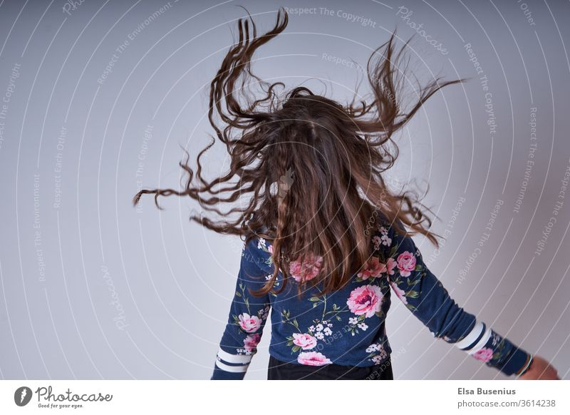 Hair flying around Hair and hairstyles Head Human being Child girl Back Infancy Colour photo sleeves Flying Jump pleased excited Hop studio recording Crazy